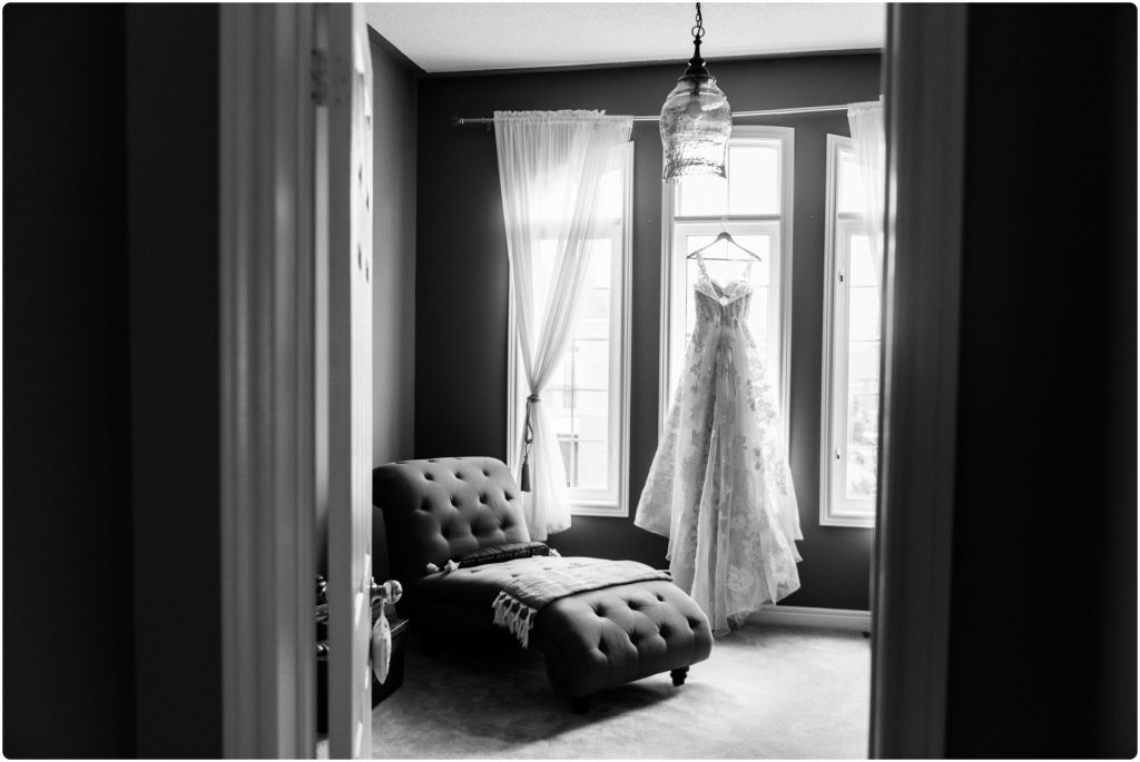 black and white wedding dress hanging in window