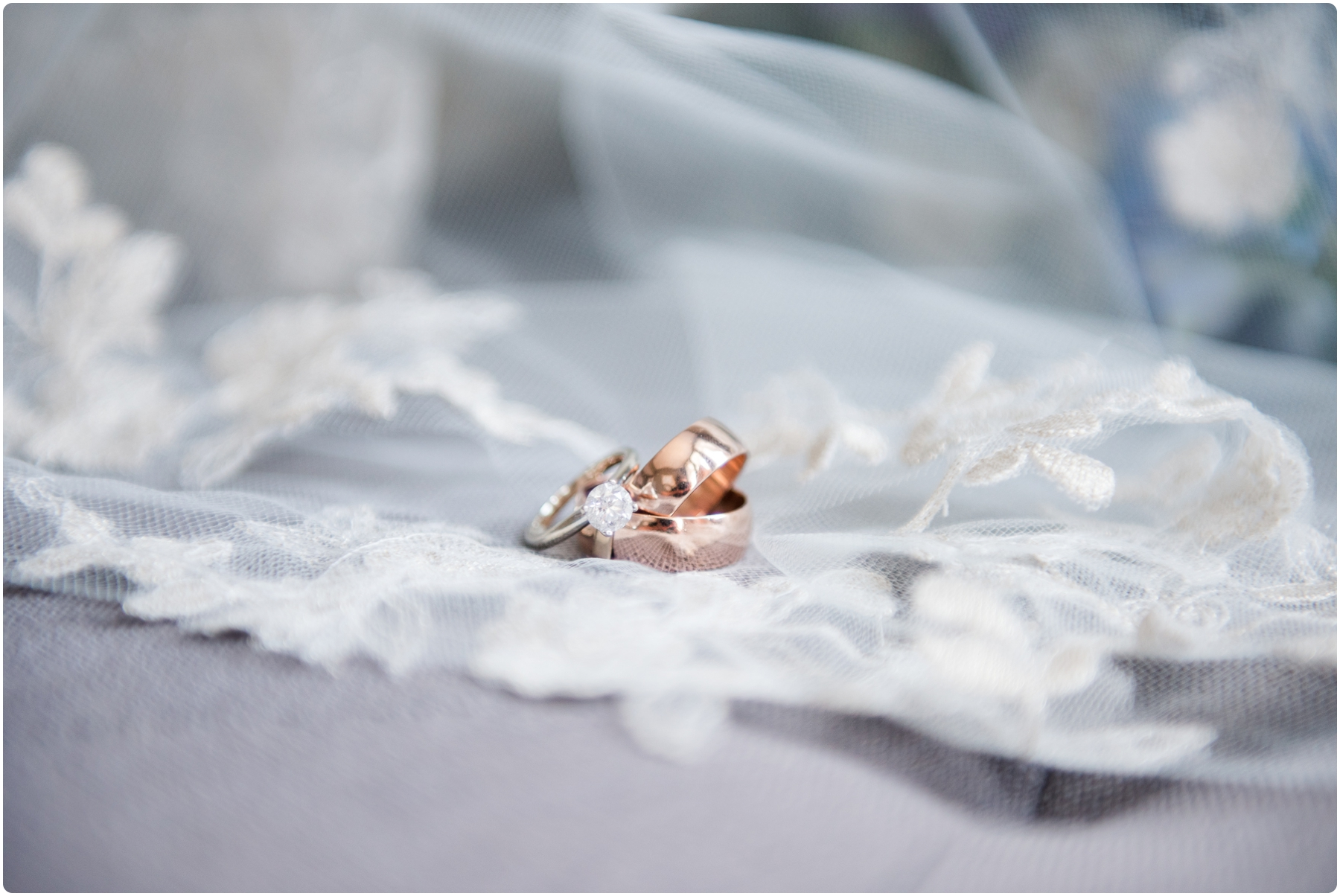 wedding rings resting on veil