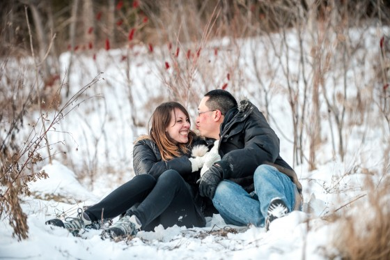 couple sitting together in snow