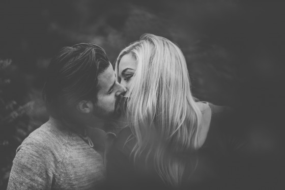 Close up of couple kissing in BW