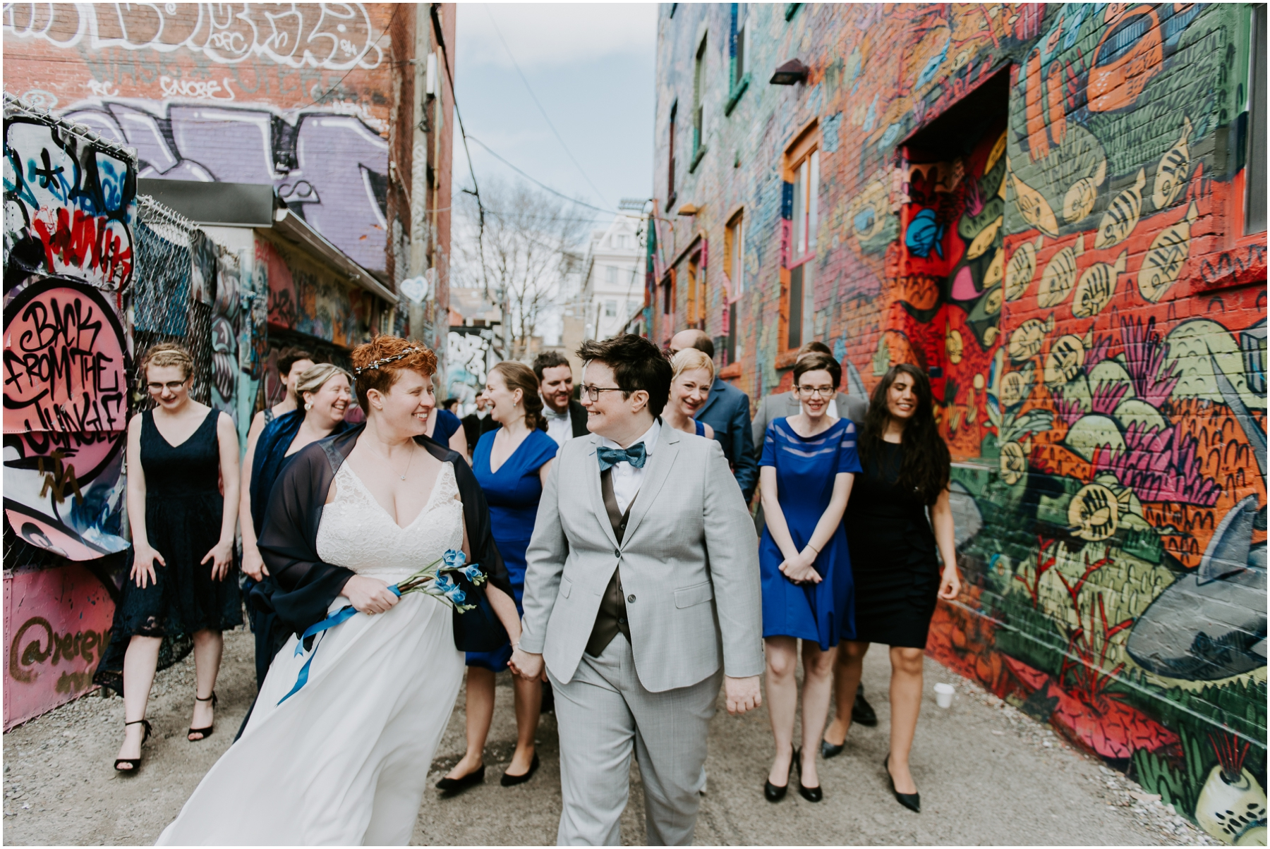 Grafitti Alley Queen W Toronto wedding party walking