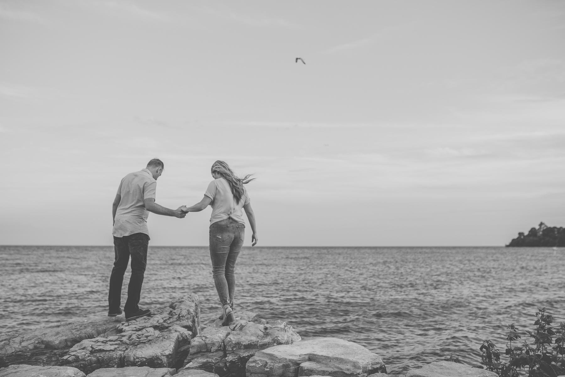 Couple walking along lake in bw