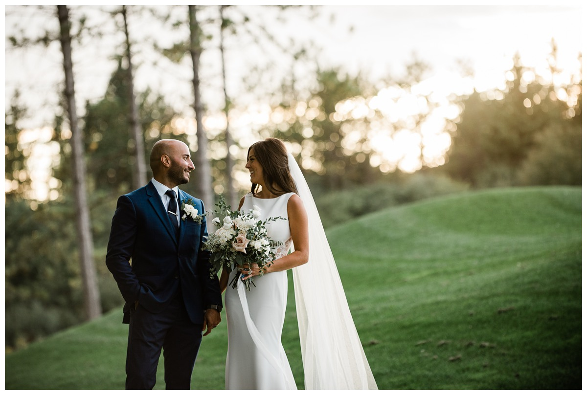 Sunset candid portrait of elegant bride and groom at Royal Ashburn wedding in Whitby