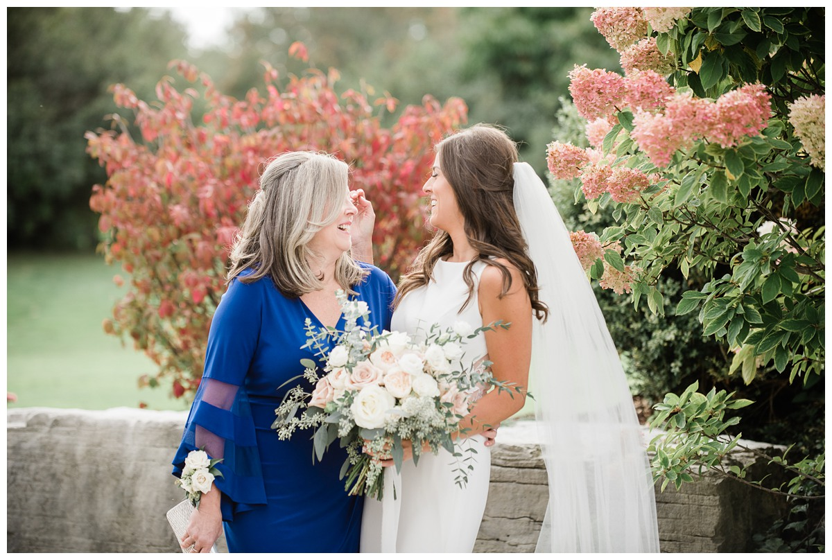 Emotional image of a bride laughing with her mother on wedding day at Royal Ashburn in Whitby