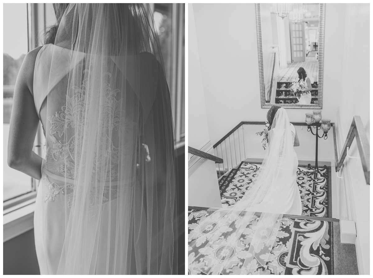 Black and write candid portrait of the back of elegant bride's dress at Royal Ashburn in Whitby
