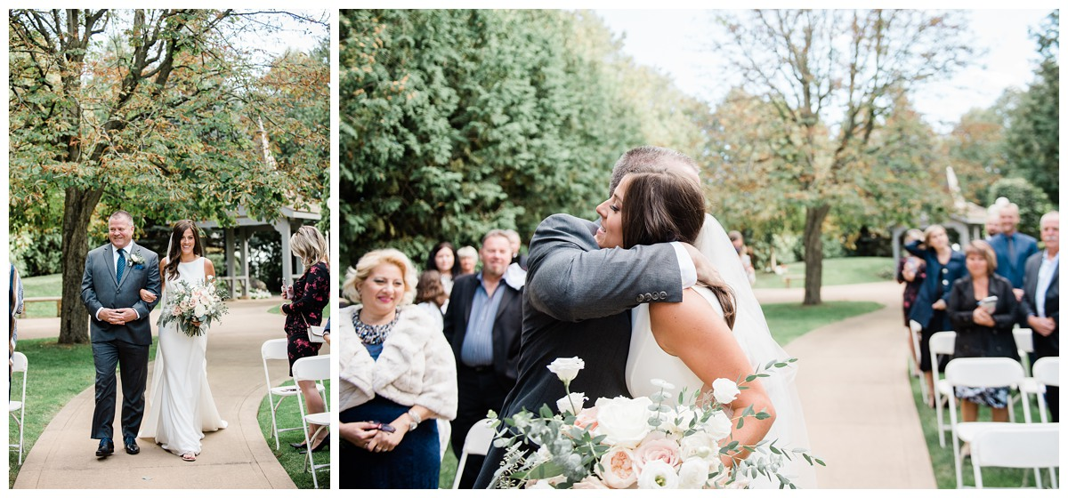 Father walks gorgeous bride down the aisle and hugs her during wedding at Royal Ashburn in Whitby