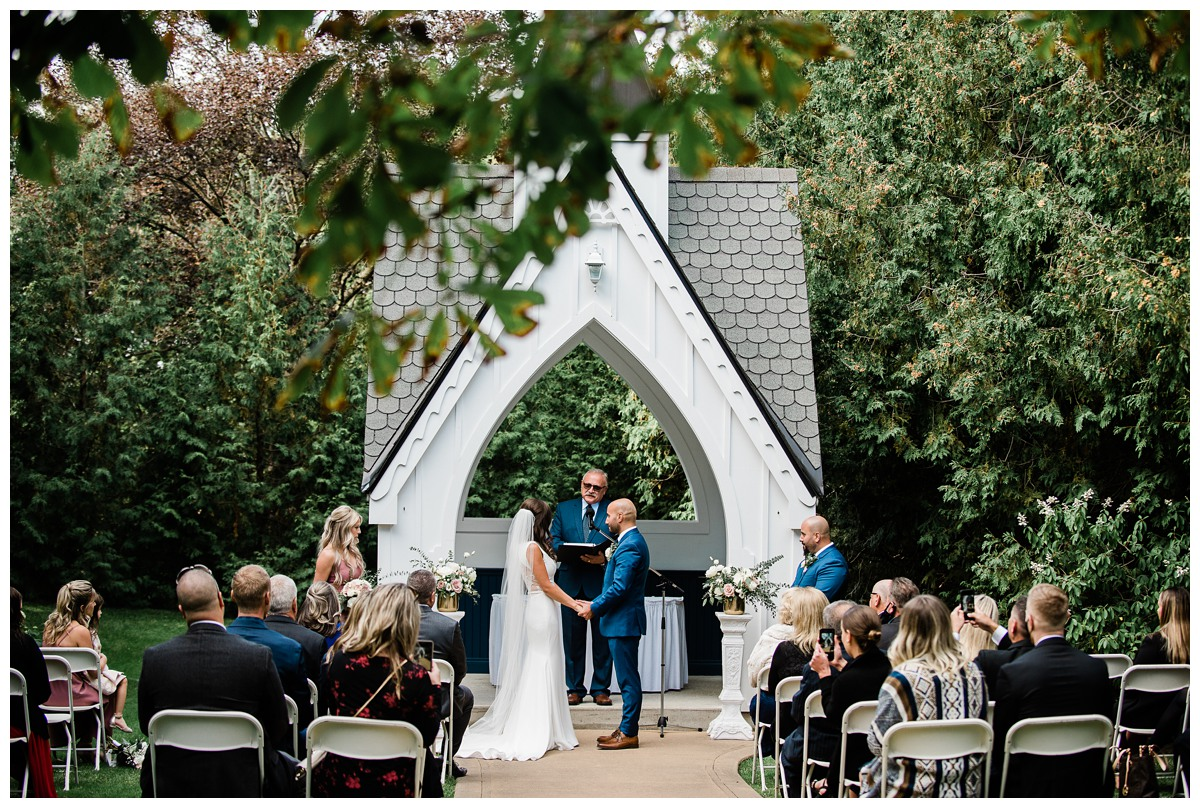 Wide image of chic bride and groom at the alter at Royal Ashburn wedding in Whitby