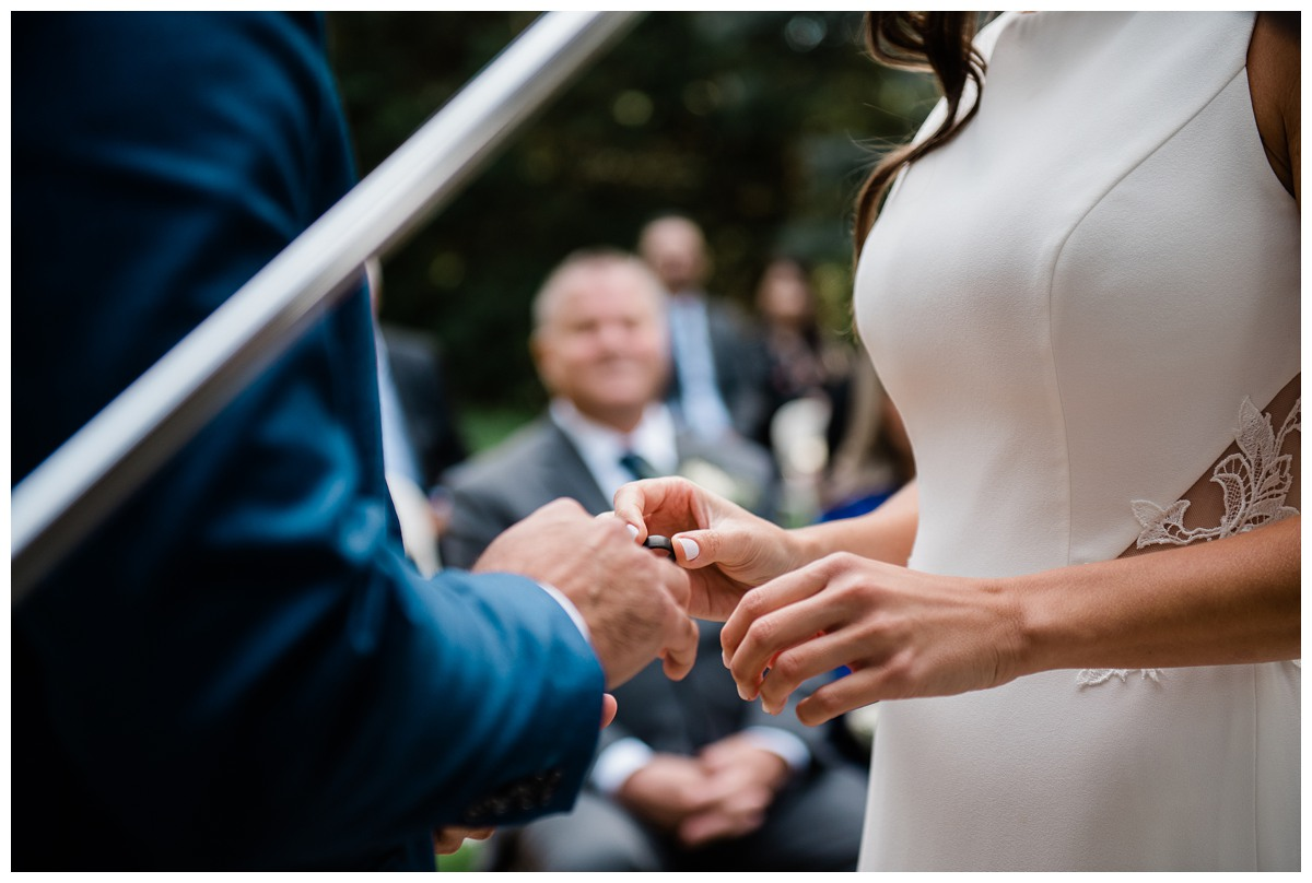 Bride and groom exchange wedding rings at Royal Ashburn Golf Club in Whitby Ontario
