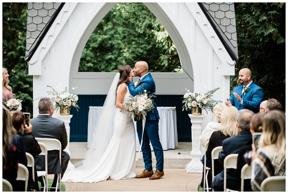 First Kiss at the alter of elegant wedding at Royal Ashburn Golf Club in Whitby