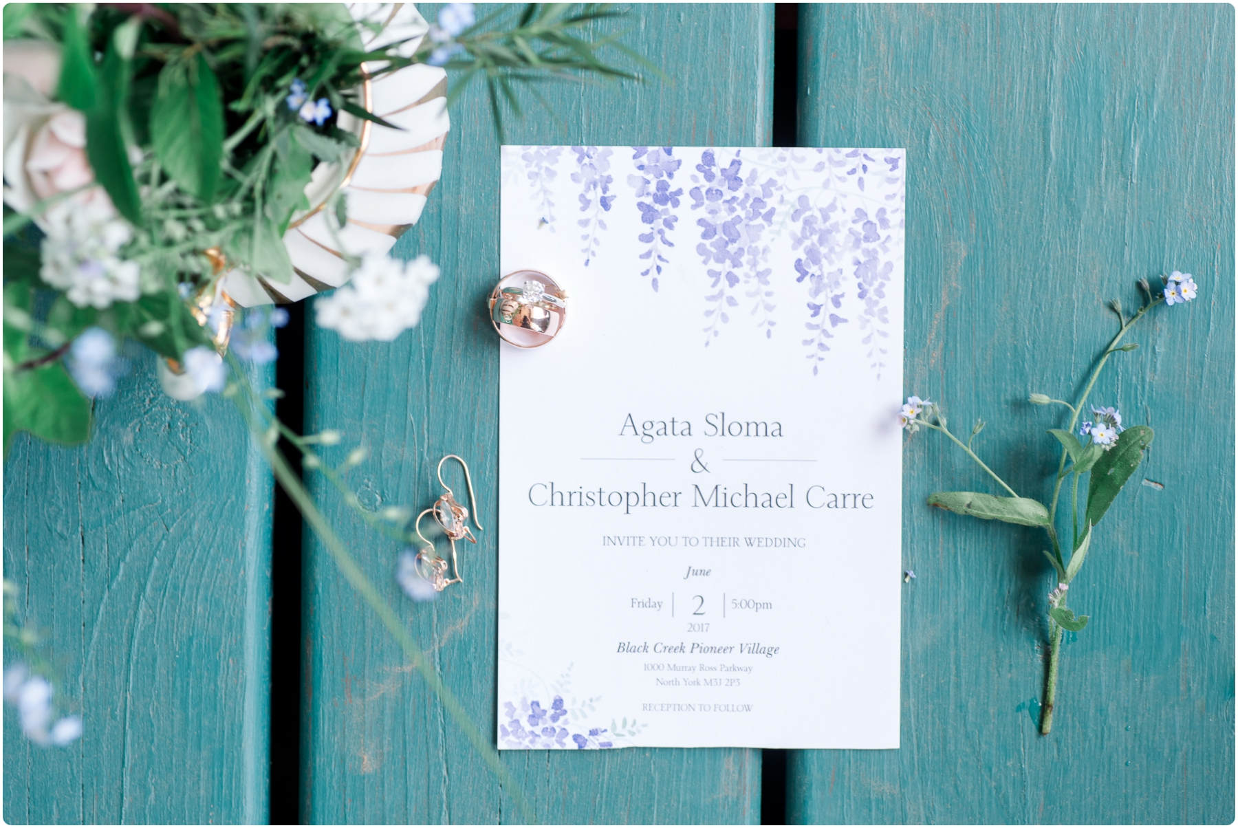 wedding details such as rings, invitation and flowers
