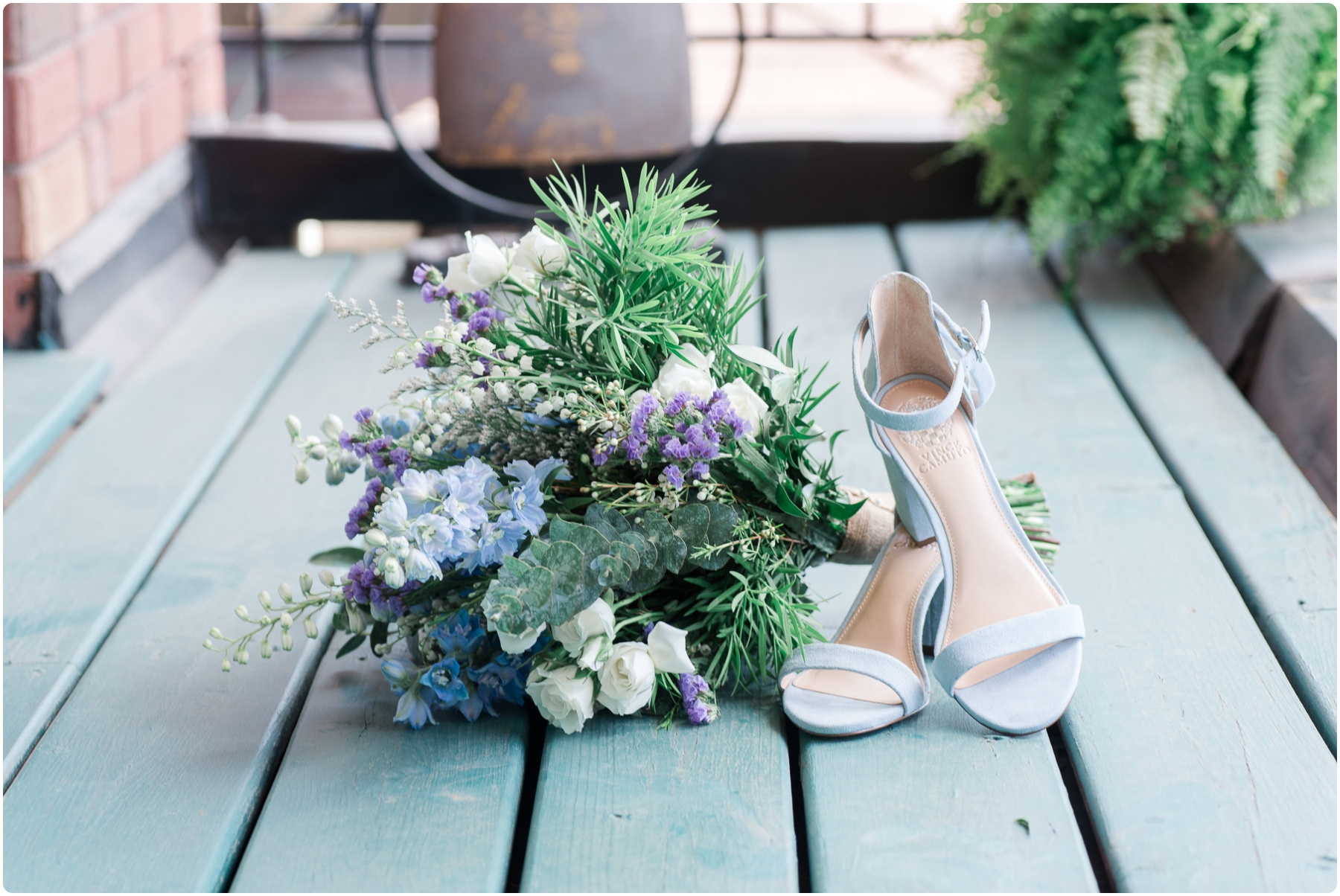 wedding bridal bouquet and blue shoes