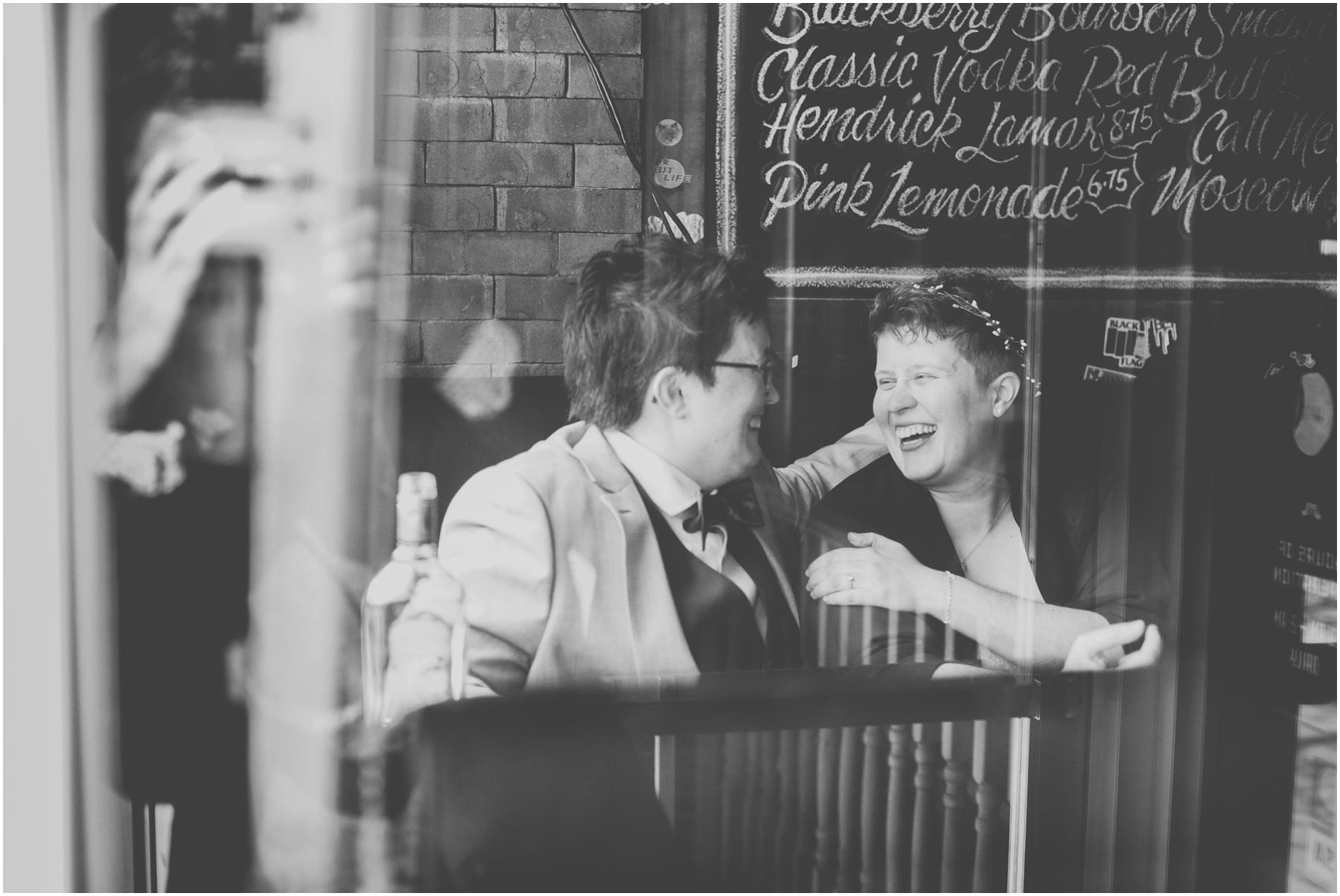 The Dime brides cuddling in window