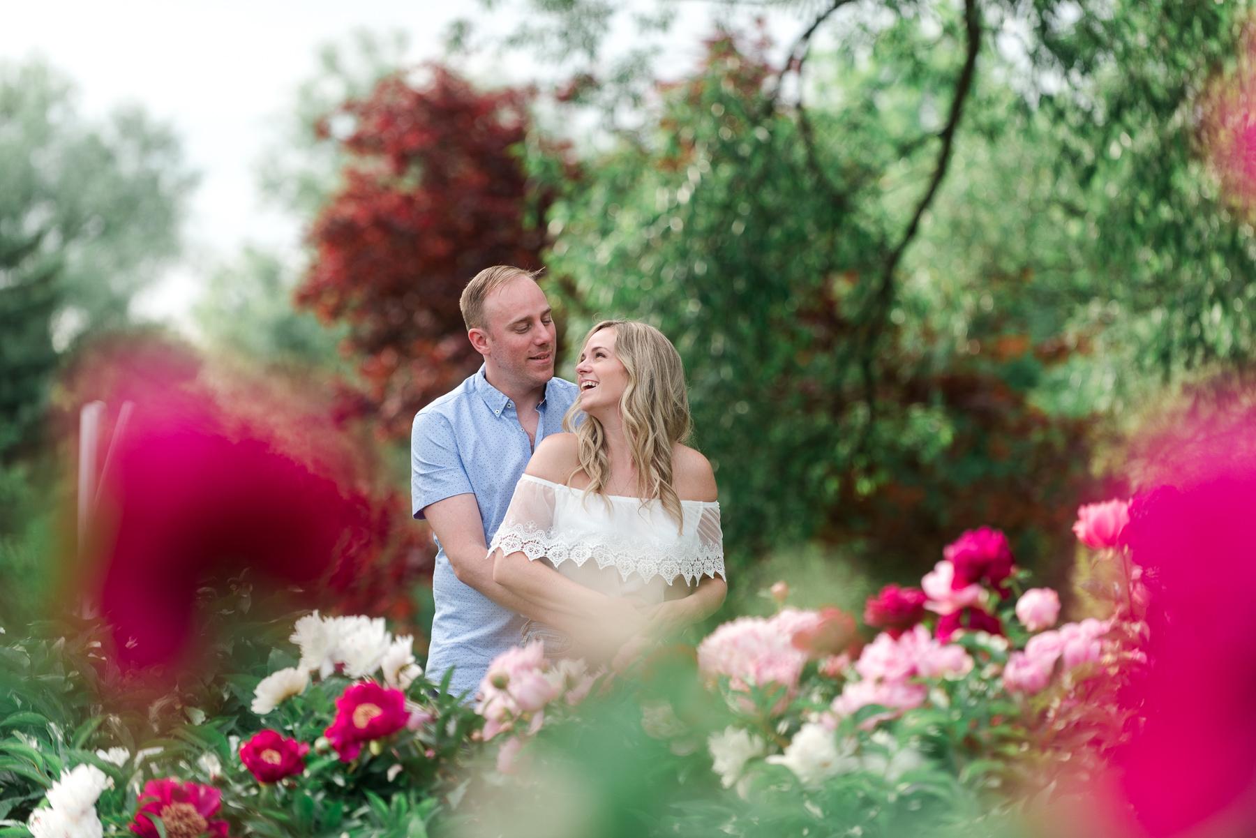 engaged couple at Peony Festival in Oshawa Valley Botanical Gardens
